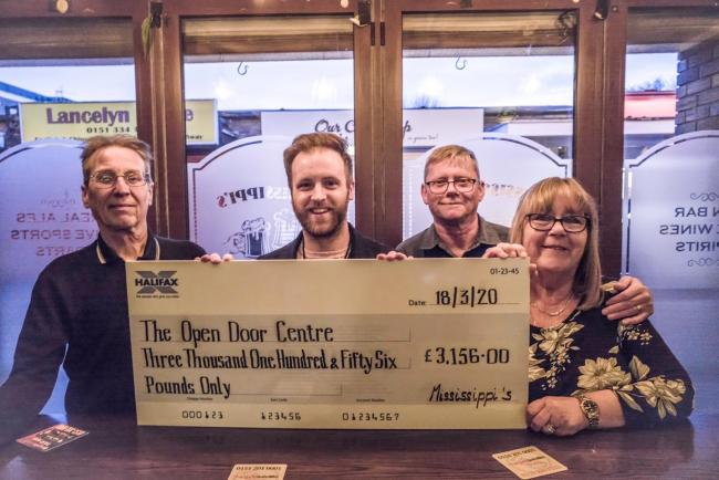 Left-right: Mississippi's Manager Neil Quinn presents the cheque to Greg Edwards (Operations Manager at Open Door Centre), alongside Martin Henderson (customer and key fundraiser) and Sue Henderson (lead fundraiser)
