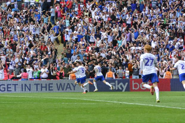 Wirral Globe: Connor Jennings celebrates his extra-time winning goal against Newport County in the play-off final at Wembley. Photo: Tony Coombes
