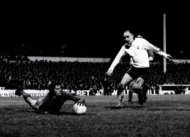 Wirral Globe: Ray Clemence dives at the feet of Tottenham's Alan Gilzean (PA)